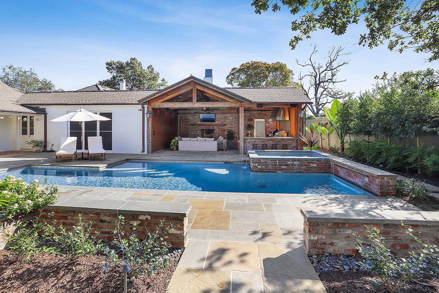 baton rouge pool with outdoor seating and kitchen
