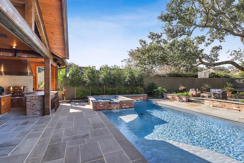 rectangular pool design with hot tub